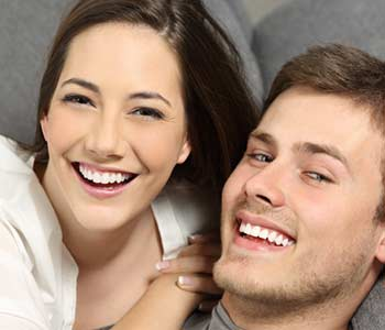Happy young couple smilling with showing their brighter teeth